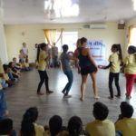 slum childrenand yoga teacher training students