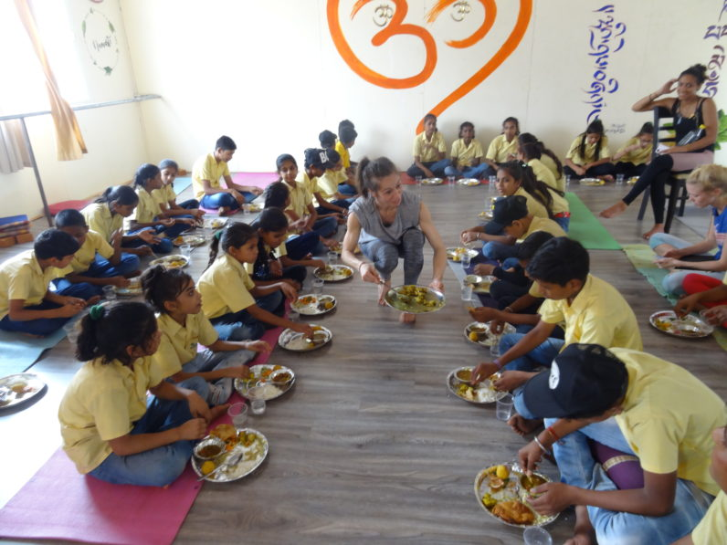Yoga Teacher Training students hand out 70 free meals to Slum Children & hold a free Yoga & Dancing Workshop