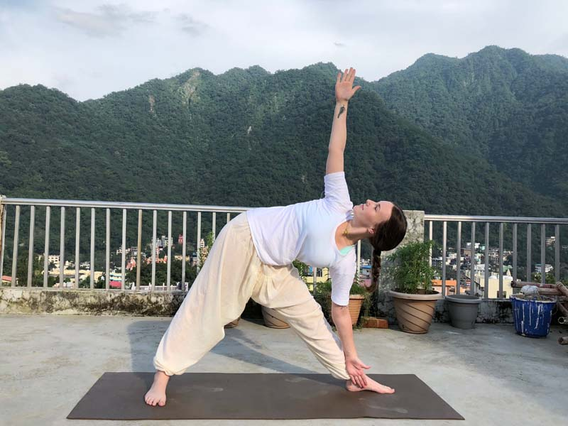 Trikonasana or Triangle Pose -Benefits, Adjustment & Cautions
