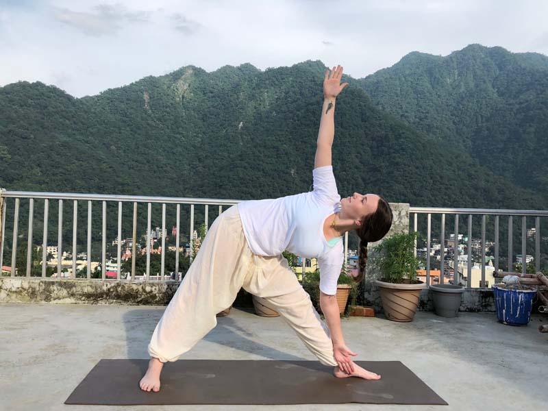 Trikonasana or Triangle Pose -Benefits, Adjustment & Cautions