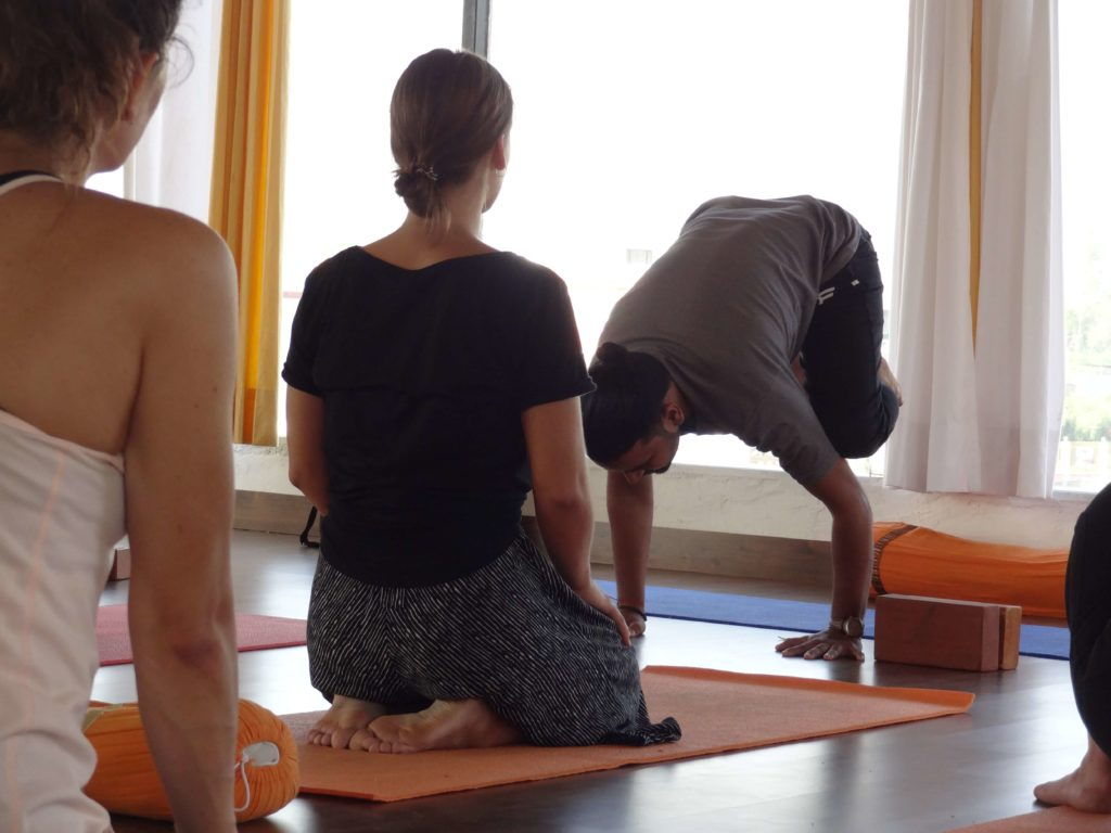 Teaching yoga class
